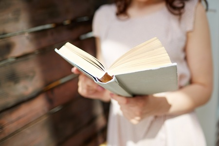 Close-up of woman reading book photo