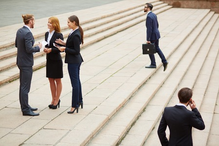 Group of business people interacting outside photo