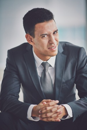 questioning: Young businessman in suit showing misunderstanding  Stock Photo