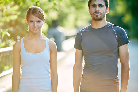 activewear: Photo of young sporty couple in activewear outdoors