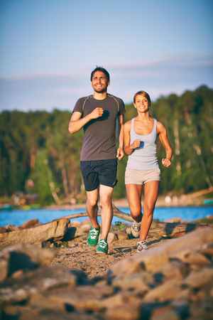 activewear: Photo of happy dates jogging in the morning Stock Photo