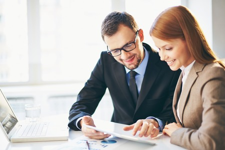 modern businessman: Young businessman explaining ideas to his colleague at meeting Stock Photo