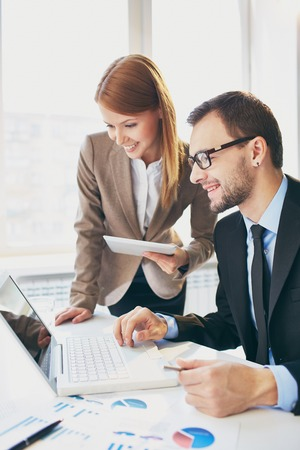 corporate training: Image of two successful business partners working at meeting in office