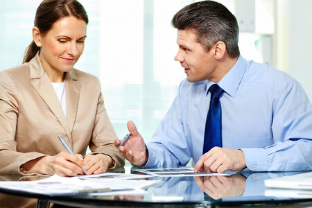 new strategy: Business partner explaining new strategy to elegant business woman