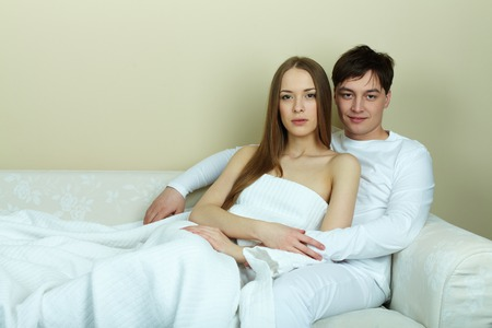 Serene female and her husband having rest at home photo