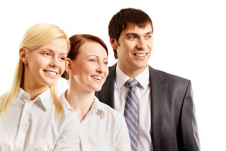Three confident business people smiling and looking away isolated on white  photo