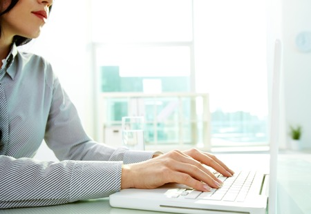 Business lady typing on laptop at office photo