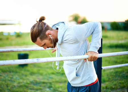 activewear: Young man training on sport equipment outside