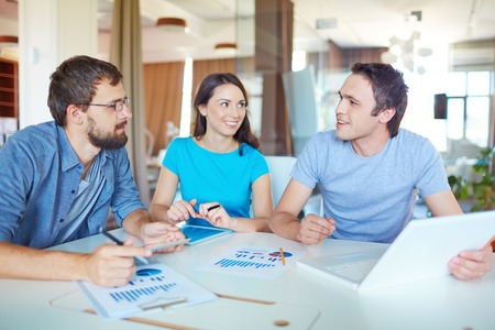 casual caucasian: Group of three successful business partners in casual working at meeting in office