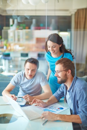 happy work: Group of three successful business partners in casual working at meeting in office