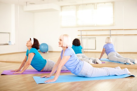 Portrait of sporty females doing stretching exercise in sport club Stock Photo