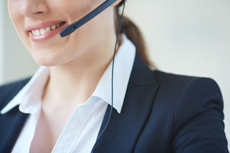 Part of smiley face of young customer support representative photo
