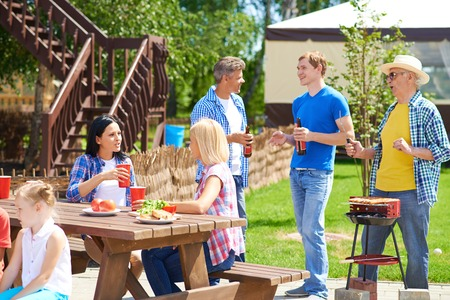 Relatives spending time together in summer photo