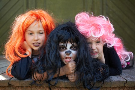 grins: Portrait of three Halloween girls looking at camera with grins Stock Photo