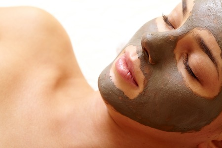 facial spa: Relaxed girl having pore cleaning mask in isolation