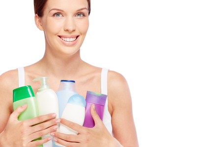 purifying: Young woman with bath products