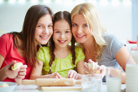 young parents: Portrait of three females at the kitchen Stock Photo