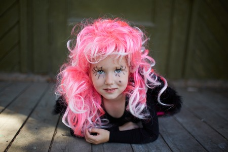 antichrist: Portrait of cute girl with pink hair looking at camera Stock Photo