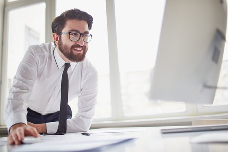 busy beard: Successful businessman working with computer in office Stock Photo
