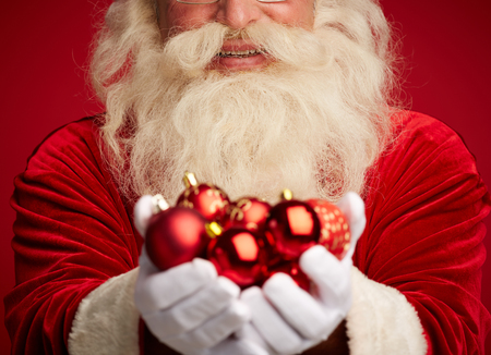 Santa holding decorative toy balls Stock Photo - 31125139