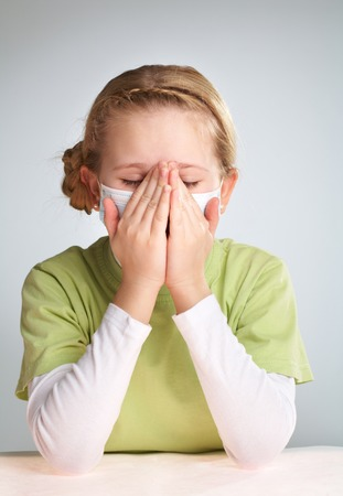 Portrait of an ill girl in face mask photo