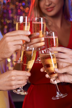 champagne flutes: Human hands with champagne flutes toasting at party