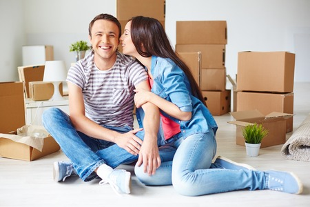 settler: Happy young couple in their new flat