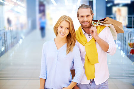 Young couple posing in shopping mall photo