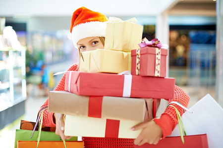 Young woman with heap of Christmas presents Stock Photo