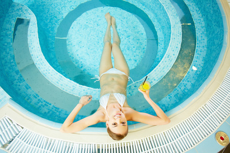 High angle view of young woman resting in swimming pool photo