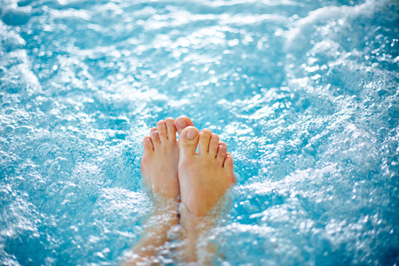 beauty spa: Close-up of female legs in hot tub