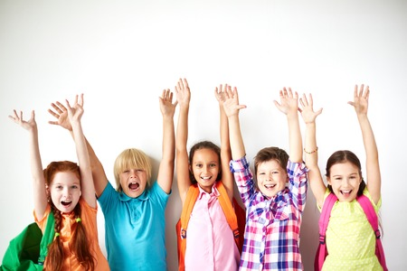 Ecstatic friends with raised arms looking at camera Stock Photo - 31364787