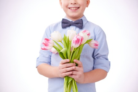 Little boy holding bunch of tulips