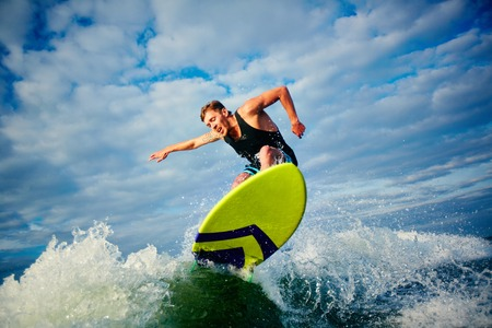 surf: Male surfer riding on board in summer