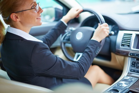 Young businesswoman driving to work