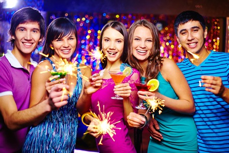 Ecstatic friends toasting at New Year party photo