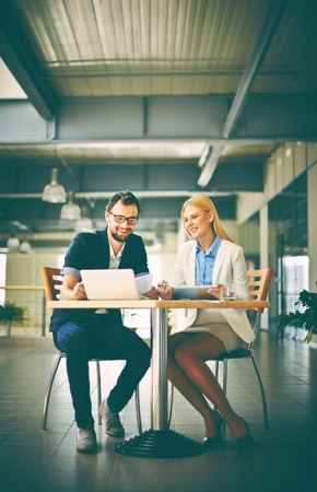 executive chair: Two colleagues networking at meeting in office Stock Photo