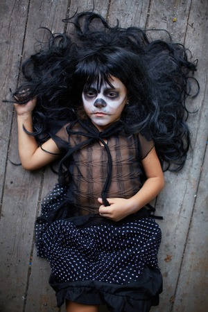 antichrist: Portrait of Halloween girl with gloomy expression