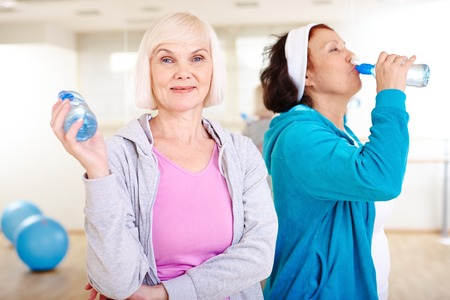 Two happy aged women after workout photo