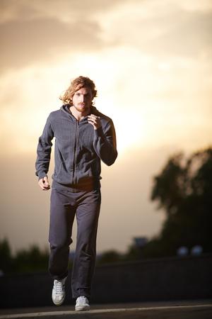 activewear: Portrait of young sportsman in activewear jogging