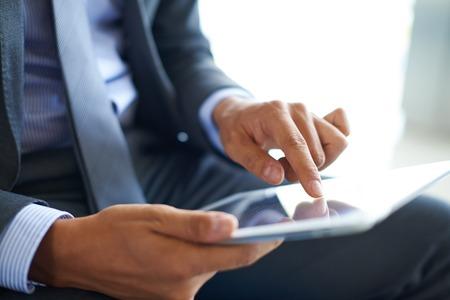 집게 손가락: Businessman forefinger pointing at document in touchpad 스톡 사진