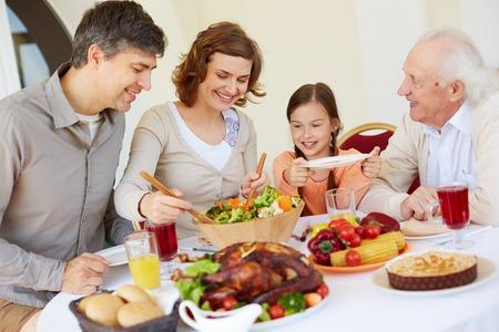 family celebration: Portrait of happy family having Thanksgiving dinner