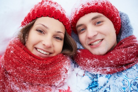 winterwear: Faces of smiling dates in winterwear looking at camera