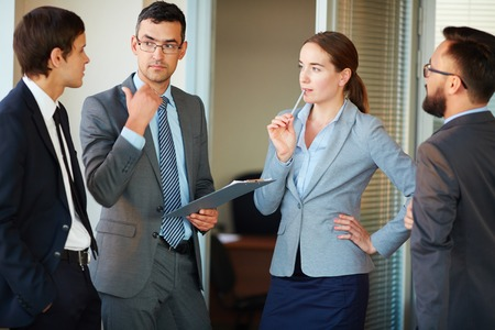 speculating: Pensive business partners speculating upon their ideas or working plans in office