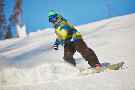 snowdrift: Active sportsman snowboarding in snowdrift