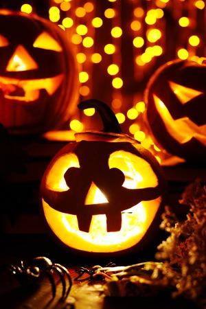 Jack-o-lanterns and spiders on sparkling  Stok Fotoğraf