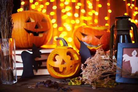 Carved pumpkins and other symbols of Halloween on sparkling  Stock Photo