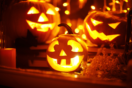 Jack-o-lanterns and other Halloween objects in a window photo