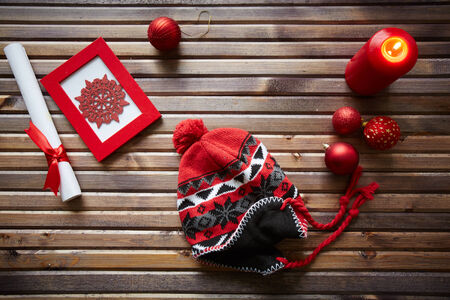 headcloth: Christmas objects, decorations and red knitted cap on wooden  Stock Photo