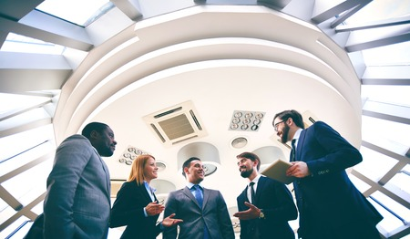 competitive business: Group of competitive business people discussing ideas or plans Stock Photo